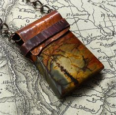 Red Creek Jasper with Hand Forged Copper Bail by SunStones on Etsy, $30.00 I selected a wonderfully patterned piece of red creek jasper for this pendant. A sheet of copper was hammered, filed, torched to add patina and formed to fit over the gemstone. A strip of copper was wrapped around to hold the pieces together.