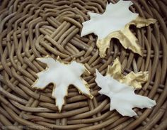 DIY plaster of paris porcelain-like Leaves with gold painted edges using inexpensive faux leaves.