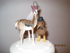 Animal bride and groom cake toppers, custom designed to your specifications.  Made from sugar by Tania Riley, South Africa. 0829316200