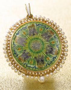 Husson, Paris A SLIM 18K YELLOW GOLD, ENAMEL AND PEARL-SET PENDANT WATCH, RETAILED BY SHREVE CRUMP & LOW CIRCA 1910