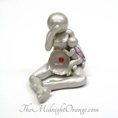 I am so, so sorry if you connect with this design. Ive been sculpting this piece for hurting hearted mothers for years now, and it never gets any easier. This sculpture is handmade and shows a grieving mother with an open womb, with her angel resting at her side comforting her. I