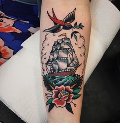 Ship tattoos are nautical themed tattoos that can be realistic or abstract. Here are the top 9 ship tattoo designs and ideas for men and women. Traditional Ship Tattoo, Traditional Ink, Traditional Sleeve, Traditional Nautical Tattoo, American Traditional Tattoos, Traditional Tattoo Meanings, Traditional Ideas, Leg Tattoos, Body Art Tattoos