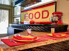 A vintage food sign and red and yellow accents add color and personality to this neutral eclectic kitchen.