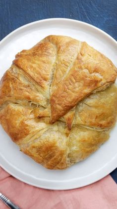 What's better than cutting into baked Brie in a puffed pastry? Cutting in to discover mac 'n' cheese inside!