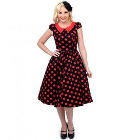 Aren't dotted dames the most divine? Presenting a lively black swing dress patterned in a vibrant large red polka dot pr...Price - $66.00-qai0kOKo