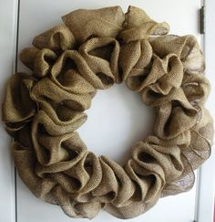 """Burlap Wreath - i once found a tutorial on how to make this but cant find it again. I think wire wreath, wire to secure burlap and """"fluff"""" burlap inbetween where the wires secure it. Make two rings of burlap (one on the inside and one of the outside) Burlap Crafts, Wreath Crafts, Diy Wreath, Diy Crafts, Burlap Wreaths, Wreath Making, Burlap Decorations, Fabric Wreath, Burlap Ribbon"""