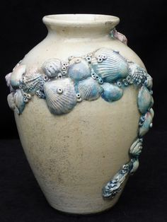 Runyan Raku clay body - clear glaze over underglazed shell embellishments - raku fired.