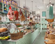 Here is a beautiful deli counter that is bright and colorful. #delidesign #delicounters