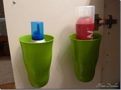 DIY Bathroom Cabinet Organization : dollar store (or Target dollar spot) plastic cups + Velcro strips = under-the-counter orgaization.