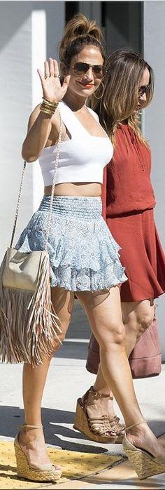 Jennifer Lopez: shirt – A.L.C.  Bracelets – Cartier  Shoes – Gucci  Skirt – Twelfth St by Cynthia Vincent