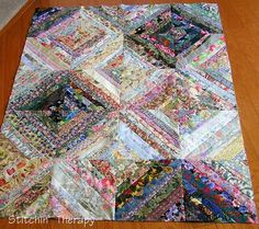 Beautiful string quilt, Debbie really has a way with those floral fabrics. Stitchin' Therapy: Something old, something new for January