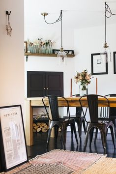 Wooden Farmhouse Table And Tolix Chairs With Pendant Lighting - Boho Industrial Dining Room With Vintage Accents