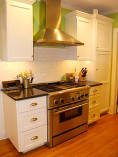 HGTV fan Felt So Cute renovated her small 1920s-style kitchen with clean, white cabinetry and a white, subway-tiled backsplash. The lime green accents add a playful splash of color without making the space feel busy or over-the-top. Take advantage of extra wall space by adding additional cabinetry and drawers. This will keep kitchen essentials organized and stored, while clearing up the countertops.