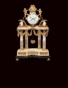 Louis XVI style ormolu-mounted black and Carrara marble mantel clock  By Ridel, Paris, Last quarter 19th Century  Modelled as a portico, the drum shaped case flanked by two cherubs holding a portrait medallion, the white enamel dial signed Ridel/Paris, above a galleried platform with urn finials, centred by a mask issuing floral garlands, on four fluted Corinthian columns, with white marble inverted breakfront base above black marble plinth, on circular flat feet 29 in. (74 cm.) high; 18 in…