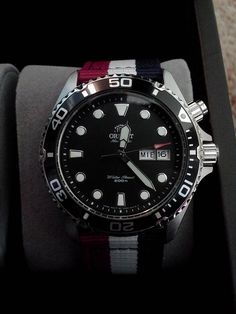I love this Orient Ray watch with red, white and blue NATO strap.