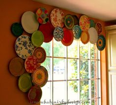 How to hang decorative plates as a cool valance. by sharene