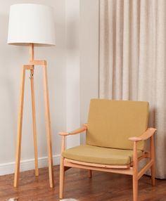 An elegant, contemporary floor lamp which omits a warm, muted glow. The ingenious base is created of three wooden elements which can be rotated and aligned for flat packing.
