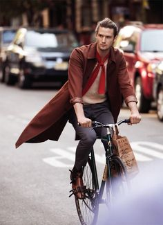 Mens Fashion: Brown Coat and red tie on a Bicycle. Great style. -Pinterest: @keraavlon