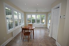 Madawaska Sun-Room Addition - traditional - family room - ottawa - by OakWood Renovation Experts