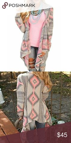 Comfy Pink & Gray Aztec Print Flowy Cardigan Beautiful soft and stretchy asymmetrical hem cardigan. Perfect for fall and winter. Add a pop of color to any outfit. Material:70% Cotton 30% Polyester. (( Please be advised that these sweaters are tagged with Asian sizes - the product you receive will be tagged one size bigger than you purchased, but the measurements will be correct. )) C.C. Boutique Sweaters Cardigans