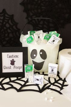 """Ghost Poop! Transform Tic Tac® mints into Ghost Poop for a spooky surprise that the whole family will enjoy. Create a 1.5"""" by 1.75"""" Ghost Poop label in your favorite editing program. Print, cut out, & adhere to the front of the Tic Tac® mints with double-sided tape. Add a ghost face to a clear or white bucket to hold your Ghost Poop! For a cute Halloween party display or to give out during Trick or Treating, pair your bucket with a sign & a roll of toilet paper. (source: @designimprovised) Cute Halloween, Halloween Treat Bags, Halloween Food For Party, Halloween Games, Halloween Birthday, Diy Halloween Decorations, Holidays Halloween, 31 Days Of Halloween, Holiday Themes"""