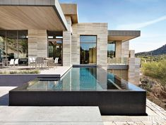 Modern Neutral Pool Area with Infinity Lap Pool #modernpoolarchitecture #modernpoolbeverlyhills