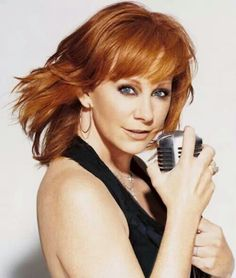 Reba McEntire, We saw her perform at the Grand Ole Opry. She is so adorable and so talented.