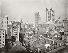 "Circa 1900. ""New York financial district from the Woodbridge Building."" The Park Row building at right was the world's tallest office tower."