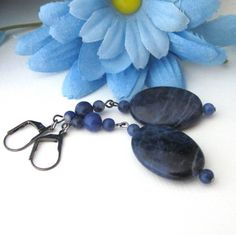 These sodalite gemstone earrings are long and dangling and have gunmetal lever back earring wires. Gunmetal is a dark gray color and a very popular choice for metals in handmade jewelry. The color of
