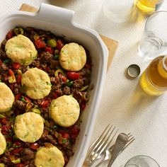 Cuban Beef Casserole with Corn-Scallion Biscuit Topping | Inspired by a Cuban picadillo, this recipe perfectly balances savory and sweet with warm aromatic spices, sweet raisins and tangy green olives.