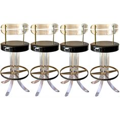 set of four lucite and chrome barstools