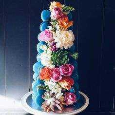 Macaron tower with navy blue macarons & succulents mixed with sweet blooms