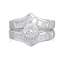 Set in sterling silver this bridal set features  a 6.8mm baguette CZ center stone Surrounded by  clear CZ. Band measures2.8mm