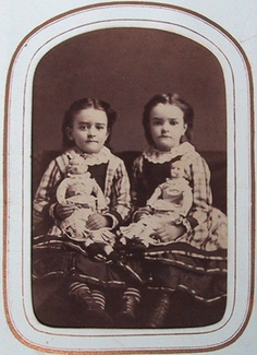 Two sisters, Minnie (born 1870) and Matie (born 1871) Sackett, with their dolls, Fredonia NY.