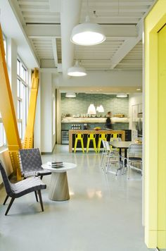 Warm bright breakout space, incorporating a kitchen so that employees can prepare fresh, healthy food, and get away from their desks.