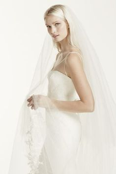 4fdceca1ccf5 Two-tier chapel length veil with raw cut edge and lace applique detail.  Beautiful