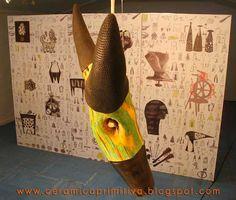 CABEZA ANIMAL Mario Carvajal. Cerámica negra y madera de Chañar
