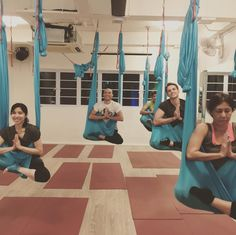 Lotus pose in the air with hammock in aerial yoga class  #HammerAerialYoga Http://www.hammeraerialyoga.com