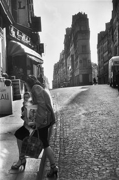 2nd arrondissement. Rue de Cléry. Paris, 1952.  by Henri Cartier-Bresson