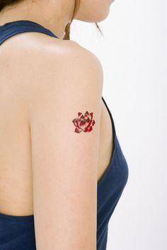 Red lotus tattoo arm