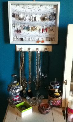 Finally found a way to organize my jewelry! Key wall mount for necklace's and a picture frame w/ lace for earrings. Bottles do bracelets old ceramics and sm boxes for the little things