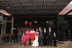 sweet bridal party with red heart balloons instead of bouquets