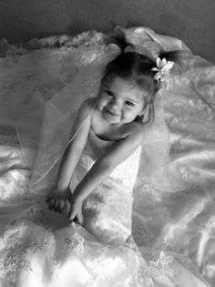 Photograph your daughter in your wedding dress to give to her on her wedding day!
