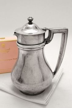 Beautiful antique hotel silver, this coffee pot from the early 1990s, Washington DC's Willard Hotel.