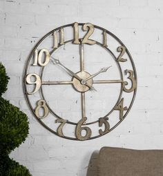 Features An Open Design And Made Of Hand Forged Metal Finished In Antiqued Silver Leaf With Burnished Edges. Quartz Movement.