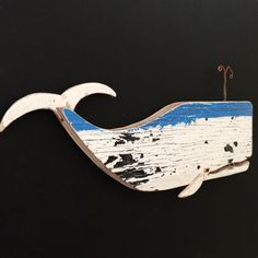 Decorative whale made of driftwood gathered from the Southern California coastline. This piece measures approximately 11 long - 5 high (top of spout to base of whale). This little guy is ready for hanging.