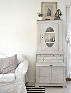 pretty white washed vintage desk...religious print above