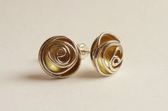 FOR THE GEM IN YOUR LIFE: Sterling silver hand fabricated studs The background of the rose has been gold plated to add warm colour to this classic form
