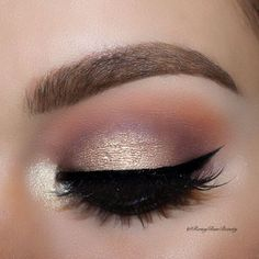 Shimmery eye makeup for photos or a night out. Purple and orange tones blended into the crease and golden shimmer on the eyes. Finish with black liquid eyeliner and glam lashes.