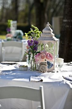 Wedding centerpieces in pink, purple and green.